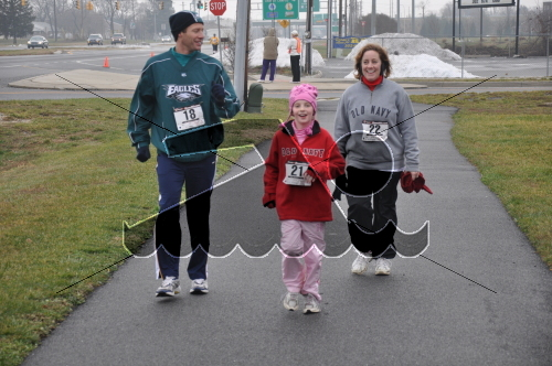 Ray, Devon, and Sheri Ott are all smiles as they approach the finish line.<br><br><br><br><a href='https://www.trisportsevents.com/pics/10_Wellness_Resolution_083.jpg' download='10_Wellness_Resolution_083.jpg'>Click here to download.</a><Br><a href='http://www.facebook.com/sharer.php?u=http:%2F%2Fwww.trisportsevents.com%2Fpics%2F10_Wellness_Resolution_083.jpg&t=Ray, Devon, and Sheri Ott are all smiles as they approach the finish line.' target='_blank'><img src='images/fb_share.png' width='100'></a>