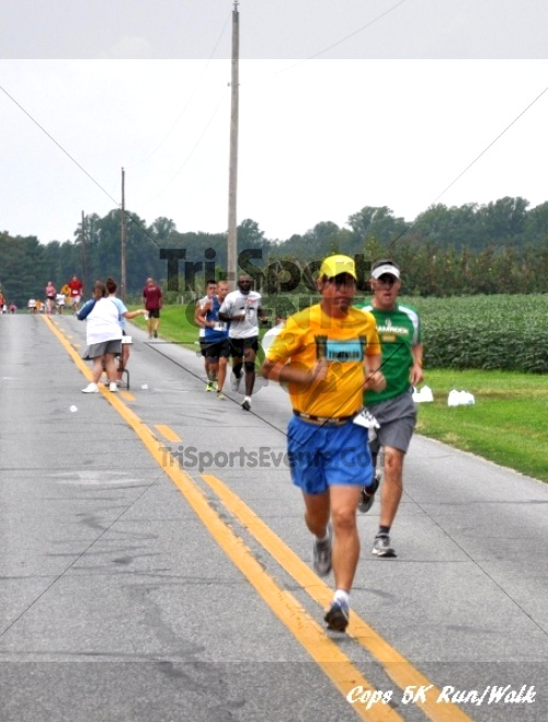 COPS 5K Run/Walk<br><br><br><br><a href='https://www.trisportsevents.com/pics/11_COPS_060.JPG' download='11_COPS_060.JPG'>Click here to download.</a><Br><a href='http://www.facebook.com/sharer.php?u=http:%2F%2Fwww.trisportsevents.com%2Fpics%2F11_COPS_060.JPG&t=COPS 5K Run/Walk' target='_blank'><img src='images/fb_share.png' width='100'></a>