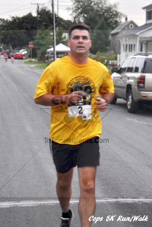 COPS 5K Run/Walk<br><br><br><br><a href='http://www.trisportsevents.com/pics/11_COPS_101.JPG' download='11_COPS_101.JPG'>Click here to download.</a><Br><a href='http://www.facebook.com/sharer.php?u=http:%2F%2Fwww.trisportsevents.com%2Fpics%2F11_COPS_101.JPG&t=COPS 5K Run/Walk' target='_blank'><img src='images/fb_share.png' width='100'></a>