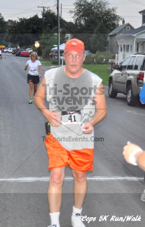 COPS 5K Run/Walk<br><br><br><br><a href='https://www.trisportsevents.com/pics/11_COPS_132.JPG' download='11_COPS_132.JPG'>Click here to download.</a><Br><a href='http://www.facebook.com/sharer.php?u=http:%2F%2Fwww.trisportsevents.com%2Fpics%2F11_COPS_132.JPG&t=COPS 5K Run/Walk' target='_blank'><img src='images/fb_share.png' width='100'></a>
