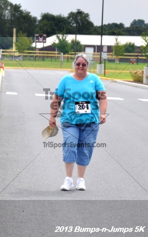 Bumps-n-Jumps 5K Run/Walk<br><br><br><br><a href='http://www.trisportsevents.com/pics/12_BMX_5K_083.JPG' download='12_BMX_5K_083.JPG'>Click here to download.</a><Br><a href='http://www.facebook.com/sharer.php?u=http:%2F%2Fwww.trisportsevents.com%2Fpics%2F12_BMX_5K_083.JPG&t=Bumps-n-Jumps 5K Run/Walk' target='_blank'><img src='images/fb_share.png' width='100'></a>