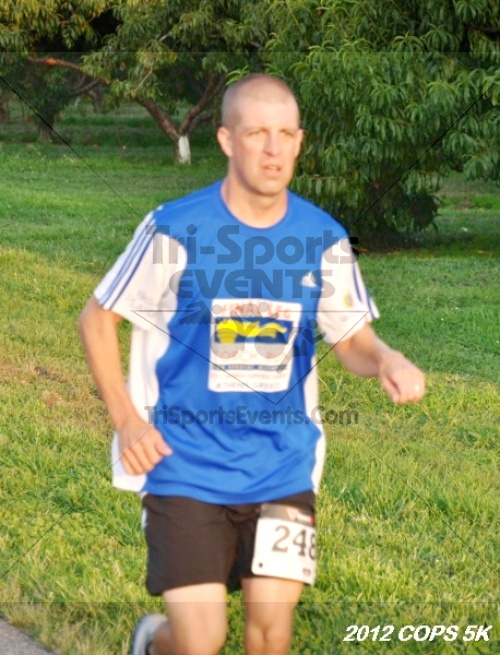 Concern of Police Survivors (COPS) 5K Run/Walk<br><br><br><br><a href='http://www.trisportsevents.com/pics/12_COPS_5K_033.JPG' download='12_COPS_5K_033.JPG'>Click here to download.</a><Br><a href='http://www.facebook.com/sharer.php?u=http:%2F%2Fwww.trisportsevents.com%2Fpics%2F12_COPS_5K_033.JPG&t=Concern of Police Survivors (COPS) 5K Run/Walk' target='_blank'><img src='images/fb_share.png' width='100'></a>