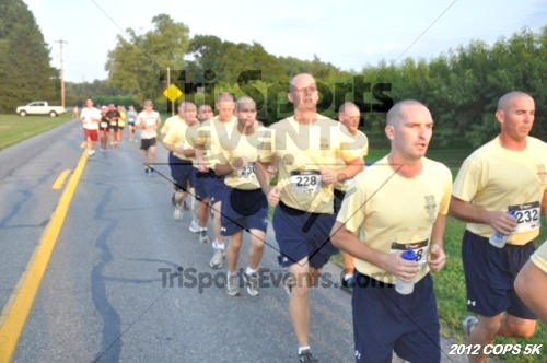 Concern of Police Survivors (COPS) 5K Run/Walk<br><br><br><br><a href='https://www.trisportsevents.com/pics/12_COPS_5K_065.JPG' download='12_COPS_5K_065.JPG'>Click here to download.</a><Br><a href='http://www.facebook.com/sharer.php?u=http:%2F%2Fwww.trisportsevents.com%2Fpics%2F12_COPS_5K_065.JPG&t=Concern of Police Survivors (COPS) 5K Run/Walk' target='_blank'><img src='images/fb_share.png' width='100'></a>