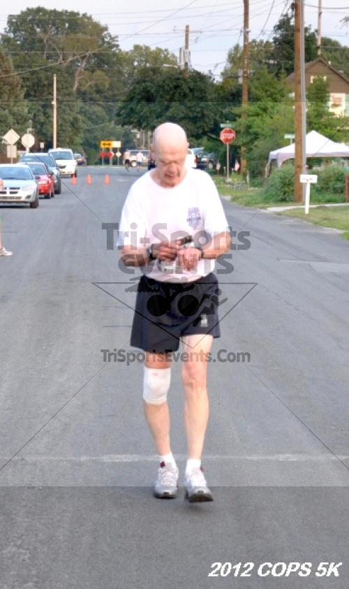 Concern of Police Survivors (COPS) 5K Run/Walk<br><br><br><br><a href='http://www.trisportsevents.com/pics/12_COPS_5K_146.JPG' download='12_COPS_5K_146.JPG'>Click here to download.</a><Br><a href='http://www.facebook.com/sharer.php?u=http:%2F%2Fwww.trisportsevents.com%2Fpics%2F12_COPS_5K_146.JPG&t=Concern of Police Survivors (COPS) 5K Run/Walk' target='_blank'><img src='images/fb_share.png' width='100'></a>
