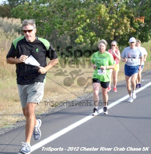 Chester River Crab Chase 5K<br><br><br><br><a href='http://www.trisportsevents.com/pics/12_Chester_River_Crab_Chase_5K_034.JPG' download='12_Chester_River_Crab_Chase_5K_034.JPG'>Click here to download.</a><Br><a href='http://www.facebook.com/sharer.php?u=http:%2F%2Fwww.trisportsevents.com%2Fpics%2F12_Chester_River_Crab_Chase_5K_034.JPG&t=Chester River Crab Chase 5K' target='_blank'><img src='images/fb_share.png' width='100'></a>
