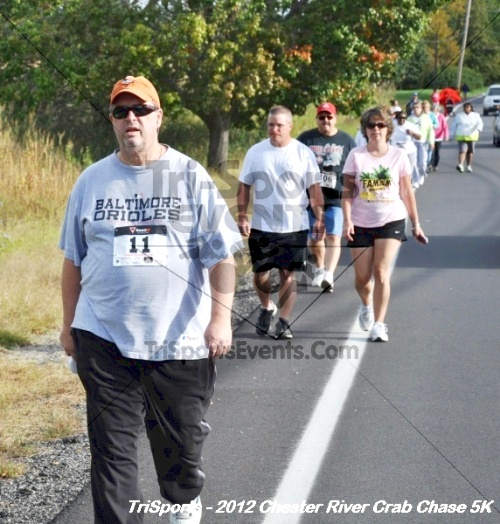 Chester River Crab Chase 5K<br><br><br><br><a href='http://www.trisportsevents.com/pics/12_Chester_River_Crab_Chase_5K_048.JPG' download='12_Chester_River_Crab_Chase_5K_048.JPG'>Click here to download.</a><Br><a href='http://www.facebook.com/sharer.php?u=http:%2F%2Fwww.trisportsevents.com%2Fpics%2F12_Chester_River_Crab_Chase_5K_048.JPG&t=Chester River Crab Chase 5K' target='_blank'><img src='images/fb_share.png' width='100'></a>