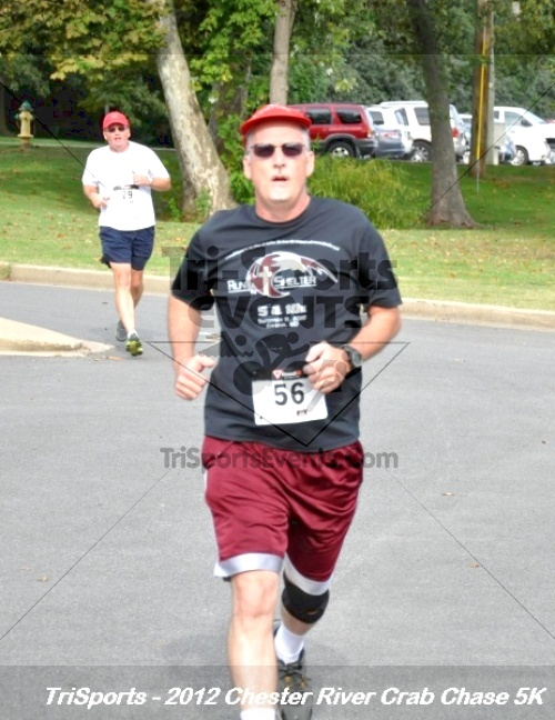 Chester River Crab Chase 5K<br><br><br><br><a href='http://www.trisportsevents.com/pics/12_Chester_River_Crab_Chase_5K_117.JPG' download='12_Chester_River_Crab_Chase_5K_117.JPG'>Click here to download.</a><Br><a href='http://www.facebook.com/sharer.php?u=http:%2F%2Fwww.trisportsevents.com%2Fpics%2F12_Chester_River_Crab_Chase_5K_117.JPG&t=Chester River Crab Chase 5K' target='_blank'><img src='images/fb_share.png' width='100'></a>