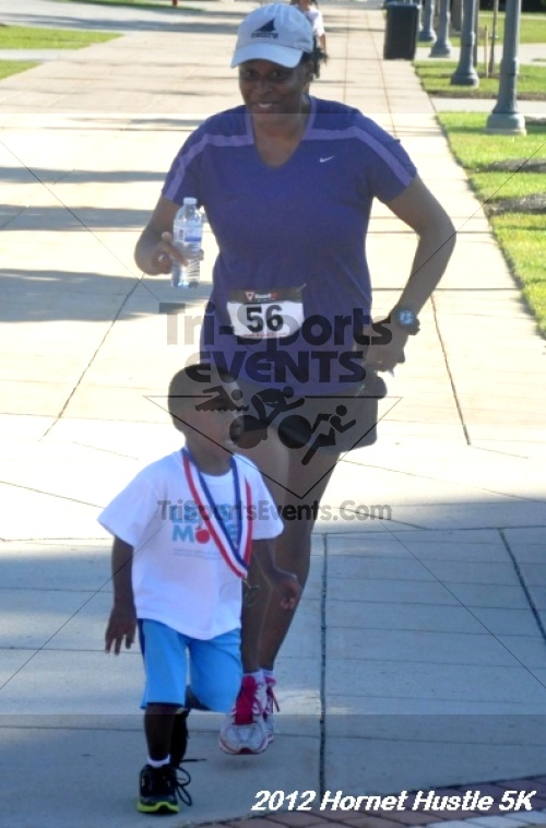 Hornet Hustle 5K Run/Walk<br><br><br><br><a href='https://www.trisportsevents.com/pics/12_DSU_5K_135.JPG' download='12_DSU_5K_135.JPG'>Click here to download.</a><Br><a href='http://www.facebook.com/sharer.php?u=http:%2F%2Fwww.trisportsevents.com%2Fpics%2F12_DSU_5K_135.JPG&t=Hornet Hustle 5K Run/Walk' target='_blank'><img src='images/fb_share.png' width='100'></a>