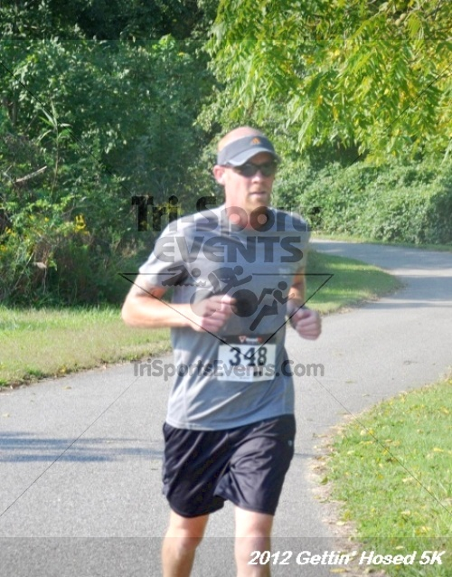 Gettin' Hosed 5K Run/Walk<br><br><br><br><a href='https://www.trisportsevents.com/pics/12_Gettin'_Hosed_5K_085.JPG' download='12_Gettin'_Hosed_5K_085.JPG'>Click here to download.</a><Br><a href='http://www.facebook.com/sharer.php?u=http:%2F%2Fwww.trisportsevents.com%2Fpics%2F12_Gettin'_Hosed_5K_085.JPG&t=Gettin' Hosed 5K Run/Walk' target='_blank'><img src='images/fb_share.png' width='100'></a>