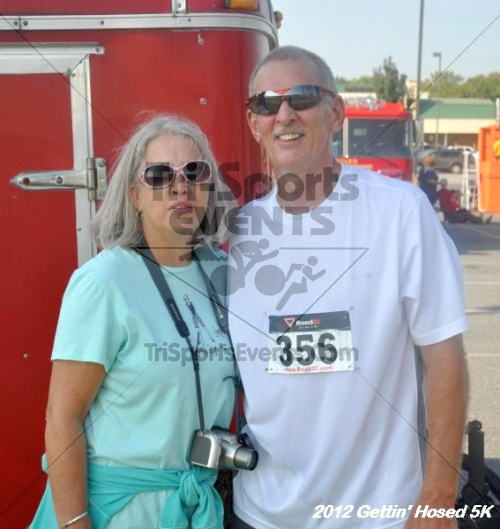 Gettin' Hosed 5K Run/Walk<br><br><br><br><a href='https://www.trisportsevents.com/pics/12_Gettin'_Hosed_5K_131.JPG' download='12_Gettin'_Hosed_5K_131.JPG'>Click here to download.</a><Br><a href='http://www.facebook.com/sharer.php?u=http:%2F%2Fwww.trisportsevents.com%2Fpics%2F12_Gettin'_Hosed_5K_131.JPG&t=Gettin' Hosed 5K Run/Walk' target='_blank'><img src='images/fb_share.png' width='100'></a>