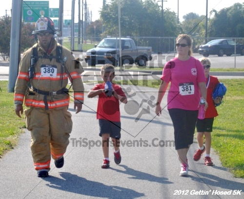 Gettin' Hosed 5K Run/Walk<br><br><br><br><a href='https://www.trisportsevents.com/pics/12_Gettin'_Hosed_5K_164.JPG' download='12_Gettin'_Hosed_5K_164.JPG'>Click here to download.</a><Br><a href='http://www.facebook.com/sharer.php?u=http:%2F%2Fwww.trisportsevents.com%2Fpics%2F12_Gettin'_Hosed_5K_164.JPG&t=Gettin' Hosed 5K Run/Walk' target='_blank'><img src='images/fb_share.png' width='100'></a>
