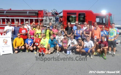 Gettin' Hosed 5K Run/Walk<br><br><br><br><a href='https://www.trisportsevents.com/pics/12_Gettin'_Hosed_5K_183.JPG' download='12_Gettin'_Hosed_5K_183.JPG'>Click here to download.</a><Br><a href='http://www.facebook.com/sharer.php?u=http:%2F%2Fwww.trisportsevents.com%2Fpics%2F12_Gettin'_Hosed_5K_183.JPG&t=Gettin' Hosed 5K Run/Walk' target='_blank'><img src='images/fb_share.png' width='100'></a>