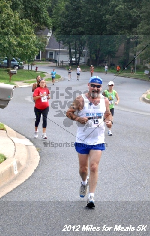 Miles for Meals 5K Run/Walk<br><br><br><br><a href='http://www.trisportsevents.com/pics/12_Miles_for_Meals_016.JPG' download='12_Miles_for_Meals_016.JPG'>Click here to download.</a><Br><a href='http://www.facebook.com/sharer.php?u=http:%2F%2Fwww.trisportsevents.com%2Fpics%2F12_Miles_for_Meals_016.JPG&t=Miles for Meals 5K Run/Walk' target='_blank'><img src='images/fb_share.png' width='100'></a>