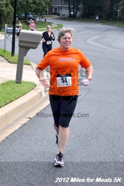 Miles for Meals 5K Run/Walk<br><br><br><br><a href='http://www.trisportsevents.com/pics/12_Miles_for_Meals_023.JPG' download='12_Miles_for_Meals_023.JPG'>Click here to download.</a><Br><a href='http://www.facebook.com/sharer.php?u=http:%2F%2Fwww.trisportsevents.com%2Fpics%2F12_Miles_for_Meals_023.JPG&t=Miles for Meals 5K Run/Walk' target='_blank'><img src='images/fb_share.png' width='100'></a>