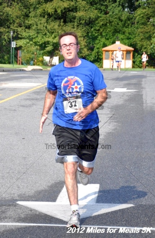 Miles for Meals 5K Run/Walk<br><br><br><br><a href='http://www.trisportsevents.com/pics/12_Miles_for_Meals_054.JPG' download='12_Miles_for_Meals_054.JPG'>Click here to download.</a><Br><a href='http://www.facebook.com/sharer.php?u=http:%2F%2Fwww.trisportsevents.com%2Fpics%2F12_Miles_for_Meals_054.JPG&t=Miles for Meals 5K Run/Walk' target='_blank'><img src='images/fb_share.png' width='100'></a>