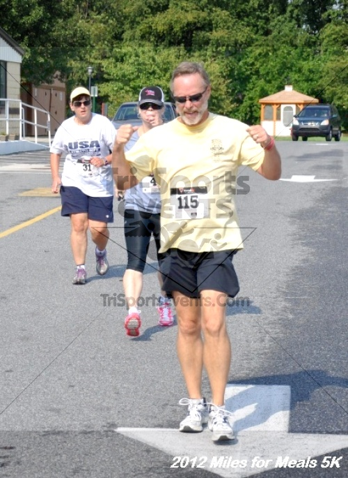Miles for Meals 5K Run/Walk<br><br><br><br><a href='http://www.trisportsevents.com/pics/12_Miles_for_Meals_074.JPG' download='12_Miles_for_Meals_074.JPG'>Click here to download.</a><Br><a href='http://www.facebook.com/sharer.php?u=http:%2F%2Fwww.trisportsevents.com%2Fpics%2F12_Miles_for_Meals_074.JPG&t=Miles for Meals 5K Run/Walk' target='_blank'><img src='images/fb_share.png' width='100'></a>