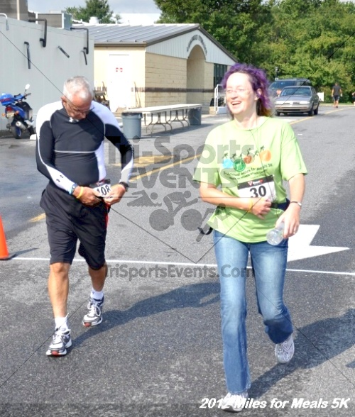Miles for Meals 5K Run/Walk<br><br><br><br><a href='http://www.trisportsevents.com/pics/12_Miles_for_Meals_078.JPG' download='12_Miles_for_Meals_078.JPG'>Click here to download.</a><Br><a href='http://www.facebook.com/sharer.php?u=http:%2F%2Fwww.trisportsevents.com%2Fpics%2F12_Miles_for_Meals_078.JPG&t=Miles for Meals 5K Run/Walk' target='_blank'><img src='images/fb_share.png' width='100'></a>