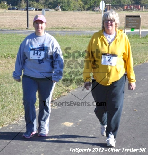 Otter Trotter 5k Run/Walk<br><br><br><br><a href='http://www.trisportsevents.com/pics/12_Otter_Trotter_080.JPG' download='12_Otter_Trotter_080.JPG'>Click here to download.</a><Br><a href='http://www.facebook.com/sharer.php?u=http:%2F%2Fwww.trisportsevents.com%2Fpics%2F12_Otter_Trotter_080.JPG&t=Otter Trotter 5k Run/Walk' target='_blank'><img src='images/fb_share.png' width='100'></a>