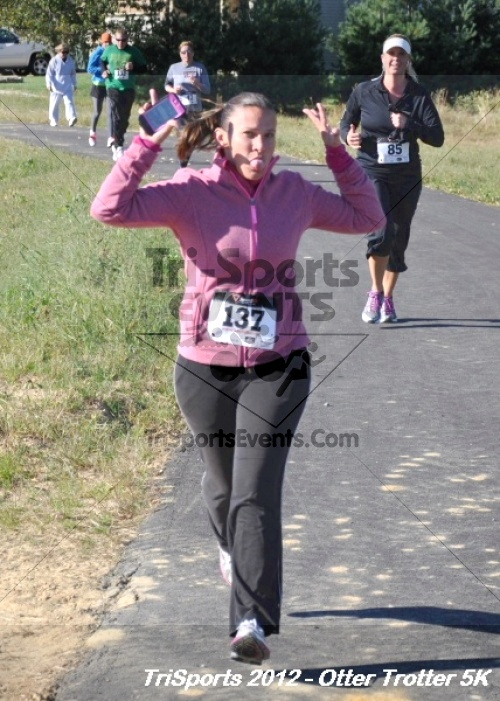 Otter Trotter 5k Run/Walk<br><br><br><br><a href='http://www.trisportsevents.com/pics/12_Otter_Trotter_100.JPG' download='12_Otter_Trotter_100.JPG'>Click here to download.</a><Br><a href='http://www.facebook.com/sharer.php?u=http:%2F%2Fwww.trisportsevents.com%2Fpics%2F12_Otter_Trotter_100.JPG&t=Otter Trotter 5k Run/Walk' target='_blank'><img src='images/fb_share.png' width='100'></a>