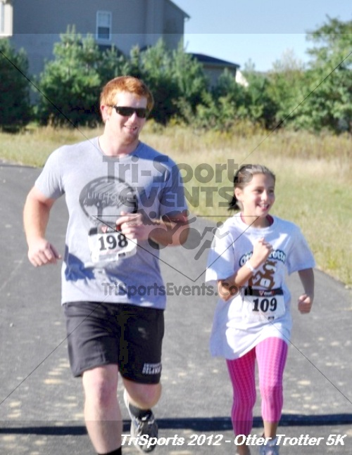 Otter Trotter 5k Run/Walk<br><br><br><br><a href='http://www.trisportsevents.com/pics/12_Otter_Trotter_115.JPG' download='12_Otter_Trotter_115.JPG'>Click here to download.</a><Br><a href='http://www.facebook.com/sharer.php?u=http:%2F%2Fwww.trisportsevents.com%2Fpics%2F12_Otter_Trotter_115.JPG&t=Otter Trotter 5k Run/Walk' target='_blank'><img src='images/fb_share.png' width='100'></a>