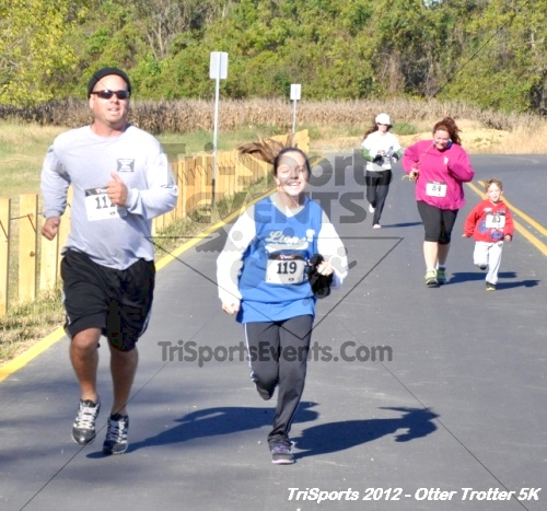 Otter Trotter 5k Run/Walk<br><br><br><br><a href='http://www.trisportsevents.com/pics/12_Otter_Trotter_144.JPG' download='12_Otter_Trotter_144.JPG'>Click here to download.</a><Br><a href='http://www.facebook.com/sharer.php?u=http:%2F%2Fwww.trisportsevents.com%2Fpics%2F12_Otter_Trotter_144.JPG&t=Otter Trotter 5k Run/Walk' target='_blank'><img src='images/fb_share.png' width='100'></a>