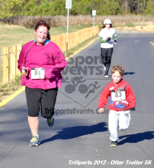 Otter Trotter 5k Run/Walk<br><br><br><br><a href='http://www.trisportsevents.com/pics/12_Otter_Trotter_145.JPG' download='12_Otter_Trotter_145.JPG'>Click here to download.</a><Br><a href='http://www.facebook.com/sharer.php?u=http:%2F%2Fwww.trisportsevents.com%2Fpics%2F12_Otter_Trotter_145.JPG&t=Otter Trotter 5k Run/Walk' target='_blank'><img src='images/fb_share.png' width='100'></a>