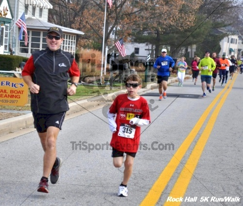 Rock Hall Reindeer Stampede 5K Run/Walk<br><br><br><br><a href='https://www.trisportsevents.com/pics/12_Rock_Hall_5K_019.JPG' download='12_Rock_Hall_5K_019.JPG'>Click here to download.</a><Br><a href='http://www.facebook.com/sharer.php?u=http:%2F%2Fwww.trisportsevents.com%2Fpics%2F12_Rock_Hall_5K_019.JPG&t=Rock Hall Reindeer Stampede 5K Run/Walk' target='_blank'><img src='images/fb_share.png' width='100'></a>