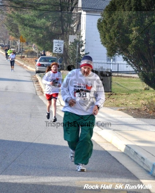 Rock Hall Reindeer Stampede 5K Run/Walk<br><br><br><br><a href='https://www.trisportsevents.com/pics/12_Rock_Hall_5K_082.JPG' download='12_Rock_Hall_5K_082.JPG'>Click here to download.</a><Br><a href='http://www.facebook.com/sharer.php?u=http:%2F%2Fwww.trisportsevents.com%2Fpics%2F12_Rock_Hall_5K_082.JPG&t=Rock Hall Reindeer Stampede 5K Run/Walk' target='_blank'><img src='images/fb_share.png' width='100'></a>