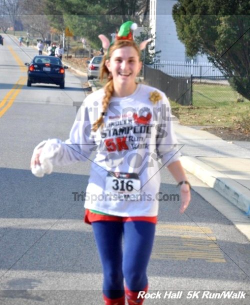 Rock Hall Reindeer Stampede 5K Run/Walk<br><br><br><br><a href='https://www.trisportsevents.com/pics/12_Rock_Hall_5K_097.JPG' download='12_Rock_Hall_5K_097.JPG'>Click here to download.</a><Br><a href='http://www.facebook.com/sharer.php?u=http:%2F%2Fwww.trisportsevents.com%2Fpics%2F12_Rock_Hall_5K_097.JPG&t=Rock Hall Reindeer Stampede 5K Run/Walk' target='_blank'><img src='images/fb_share.png' width='100'></a>