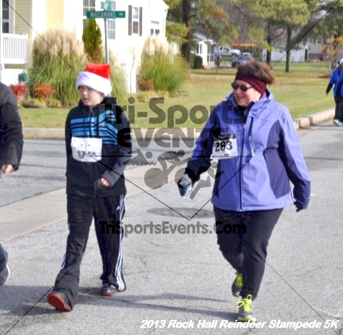 Rock Hall Reindeer Stampede 5K<br><br><br><br><a href='http://www.trisportsevents.com/pics/13_Rock_Hall_Stampede_085.JPG' download='13_Rock_Hall_Stampede_085.JPG'>Click here to download.</a><Br><a href='http://www.facebook.com/sharer.php?u=http:%2F%2Fwww.trisportsevents.com%2Fpics%2F13_Rock_Hall_Stampede_085.JPG&t=Rock Hall Reindeer Stampede 5K' target='_blank'><img src='images/fb_share.png' width='100'></a>