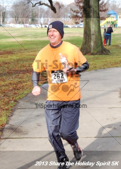Share the Holiday Spirit 5K<br><br><br><br><a href='http://www.trisportsevents.com/pics/142.JPG' download='142.JPG'>Click here to download.</a><Br><a href='http://www.facebook.com/sharer.php?u=http:%2F%2Fwww.trisportsevents.com%2Fpics%2F142.JPG&t=Share the Holiday Spirit 5K' target='_blank'><img src='images/fb_share.png' width='100'></a>