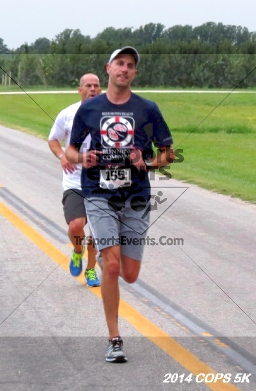 COPS 5K Run/Walk<br><br><br><br><a href='http://www.trisportsevents.com/pics/14_COPS_5K_097.JPG' download='14_COPS_5K_097.JPG'>Click here to download.</a><Br><a href='http://www.facebook.com/sharer.php?u=http:%2F%2Fwww.trisportsevents.com%2Fpics%2F14_COPS_5K_097.JPG&t=COPS 5K Run/Walk' target='_blank'><img src='images/fb_share.png' width='100'></a>