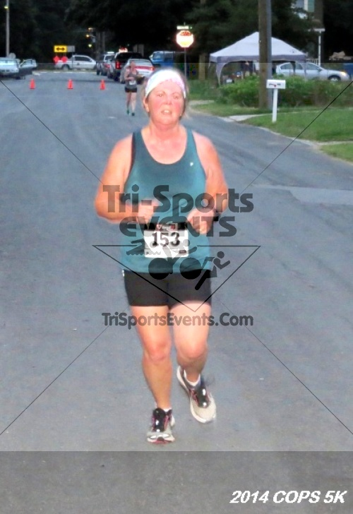 COPS 5K Run/Walk<br><br><br><br><a href='http://www.trisportsevents.com/pics/14_COPS_5K_179.JPG' download='14_COPS_5K_179.JPG'>Click here to download.</a><Br><a href='http://www.facebook.com/sharer.php?u=http:%2F%2Fwww.trisportsevents.com%2Fpics%2F14_COPS_5K_179.JPG&t=COPS 5K Run/Walk' target='_blank'><img src='images/fb_share.png' width='100'></a>