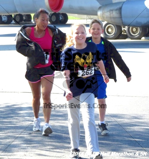 Dover Air Force Base Heritage Half Marathon<br><br><br><br><a href='https://www.trisportsevents.com/pics/14_DAFB_Half_Marathon_&_5K_099.JPG' download='14_DAFB_Half_Marathon_&_5K_099.JPG'>Click here to download.</a><Br><a href='http://www.facebook.com/sharer.php?u=http:%2F%2Fwww.trisportsevents.com%2Fpics%2F14_DAFB_Half_Marathon_&_5K_099.JPG&t=Dover Air Force Base Heritage Half Marathon' target='_blank'><img src='images/fb_share.png' width='100'></a>