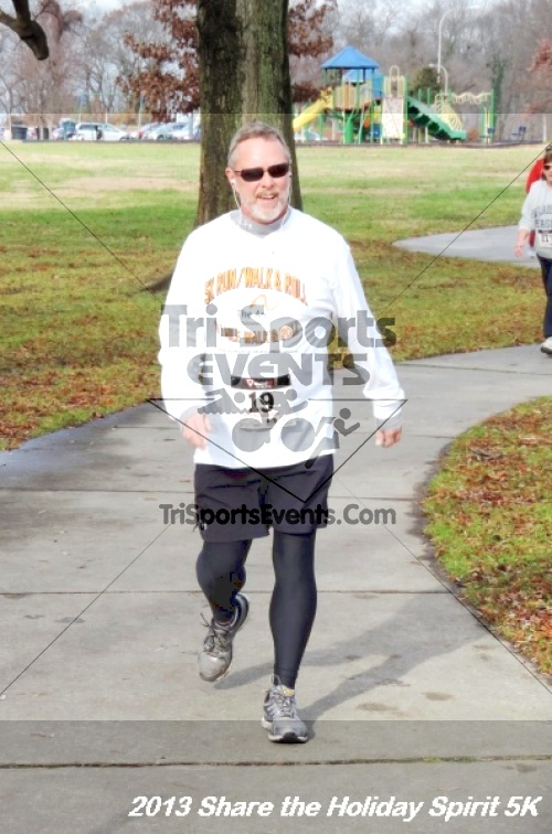 Share the Holiday Spirit 5K<br><br><br><br><a href='http://www.trisportsevents.com/pics/159.JPG' download='159.JPG'>Click here to download.</a><Br><a href='http://www.facebook.com/sharer.php?u=http:%2F%2Fwww.trisportsevents.com%2Fpics%2F159.JPG&t=Share the Holiday Spirit 5K' target='_blank'><img src='images/fb_share.png' width='100'></a>