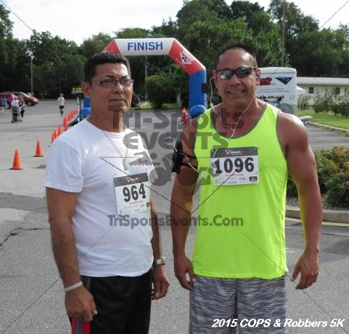 COPS & Robbers 5K Run/Walk<br><br><br><br><a href='https://www.trisportsevents.com/pics/15_COPS_&_Robbers_5K_007.JPG' download='15_COPS_&_Robbers_5K_007.JPG'>Click here to download.</a><Br><a href='http://www.facebook.com/sharer.php?u=http:%2F%2Fwww.trisportsevents.com%2Fpics%2F15_COPS_&_Robbers_5K_007.JPG&t=COPS & Robbers 5K Run/Walk' target='_blank'><img src='images/fb_share.png' width='100'></a>