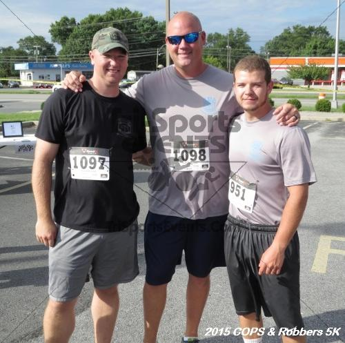 COPS & Robbers 5K Run/Walk<br><br><br><br><a href='http://www.trisportsevents.com/pics/15_COPS_&_Robbers_5K_023.JPG' download='15_COPS_&_Robbers_5K_023.JPG'>Click here to download.</a><Br><a href='http://www.facebook.com/sharer.php?u=http:%2F%2Fwww.trisportsevents.com%2Fpics%2F15_COPS_&_Robbers_5K_023.JPG&t=COPS & Robbers 5K Run/Walk' target='_blank'><img src='images/fb_share.png' width='100'></a>