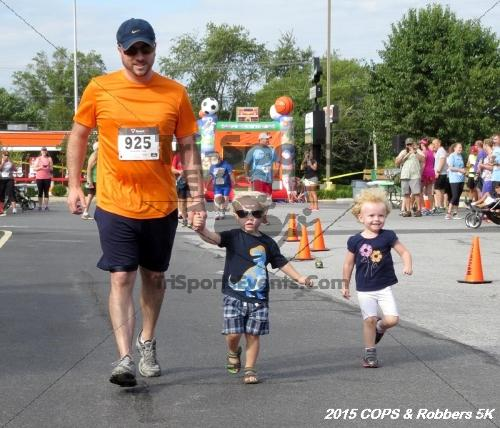 COPS & Robbers 5K Run/Walk<br><br><br><br><a href='https://www.trisportsevents.com/pics/15_COPS_&_Robbers_5K_030.JPG' download='15_COPS_&_Robbers_5K_030.JPG'>Click here to download.</a><Br><a href='http://www.facebook.com/sharer.php?u=http:%2F%2Fwww.trisportsevents.com%2Fpics%2F15_COPS_&_Robbers_5K_030.JPG&t=COPS & Robbers 5K Run/Walk' target='_blank'><img src='images/fb_share.png' width='100'></a>
