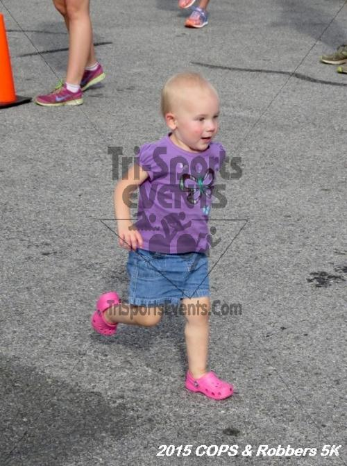 COPS & Robbers 5K Run/Walk<br><br><br><br><a href='http://www.trisportsevents.com/pics/15_COPS_&_Robbers_5K_032.JPG' download='15_COPS_&_Robbers_5K_032.JPG'>Click here to download.</a><Br><a href='http://www.facebook.com/sharer.php?u=http:%2F%2Fwww.trisportsevents.com%2Fpics%2F15_COPS_&_Robbers_5K_032.JPG&t=COPS & Robbers 5K Run/Walk' target='_blank'><img src='images/fb_share.png' width='100'></a>