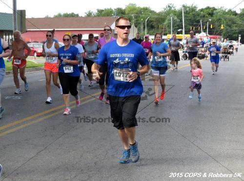 COPS & Robbers 5K Run/Walk<br><br><br><br><a href='http://www.trisportsevents.com/pics/15_COPS_&_Robbers_5K_045.JPG' download='15_COPS_&_Robbers_5K_045.JPG'>Click here to download.</a><Br><a href='http://www.facebook.com/sharer.php?u=http:%2F%2Fwww.trisportsevents.com%2Fpics%2F15_COPS_&_Robbers_5K_045.JPG&t=COPS & Robbers 5K Run/Walk' target='_blank'><img src='images/fb_share.png' width='100'></a>