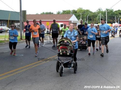 COPS & Robbers 5K Run/Walk<br><br><br><br><a href='https://www.trisportsevents.com/pics/15_COPS_&_Robbers_5K_048.JPG' download='15_COPS_&_Robbers_5K_048.JPG'>Click here to download.</a><Br><a href='http://www.facebook.com/sharer.php?u=http:%2F%2Fwww.trisportsevents.com%2Fpics%2F15_COPS_&_Robbers_5K_048.JPG&t=COPS & Robbers 5K Run/Walk' target='_blank'><img src='images/fb_share.png' width='100'></a>