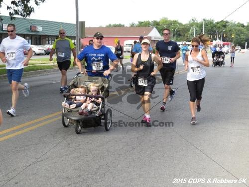 COPS & Robbers 5K Run/Walk<br><br><br><br><a href='https://www.trisportsevents.com/pics/15_COPS_&_Robbers_5K_049.JPG' download='15_COPS_&_Robbers_5K_049.JPG'>Click here to download.</a><Br><a href='http://www.facebook.com/sharer.php?u=http:%2F%2Fwww.trisportsevents.com%2Fpics%2F15_COPS_&_Robbers_5K_049.JPG&t=COPS & Robbers 5K Run/Walk' target='_blank'><img src='images/fb_share.png' width='100'></a>