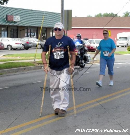 COPS & Robbers 5K Run/Walk<br><br><br><br><a href='http://www.trisportsevents.com/pics/15_COPS_&_Robbers_5K_051.JPG' download='15_COPS_&_Robbers_5K_051.JPG'>Click here to download.</a><Br><a href='http://www.facebook.com/sharer.php?u=http:%2F%2Fwww.trisportsevents.com%2Fpics%2F15_COPS_&_Robbers_5K_051.JPG&t=COPS & Robbers 5K Run/Walk' target='_blank'><img src='images/fb_share.png' width='100'></a>