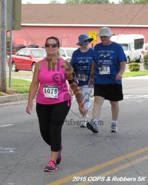 COPS & Robbers 5K Run/Walk<br><br><br><br><a href='http://www.trisportsevents.com/pics/15_COPS_&_Robbers_5K_053.JPG' download='15_COPS_&_Robbers_5K_053.JPG'>Click here to download.</a><Br><a href='http://www.facebook.com/sharer.php?u=http:%2F%2Fwww.trisportsevents.com%2Fpics%2F15_COPS_&_Robbers_5K_053.JPG&t=COPS & Robbers 5K Run/Walk' target='_blank'><img src='images/fb_share.png' width='100'></a>