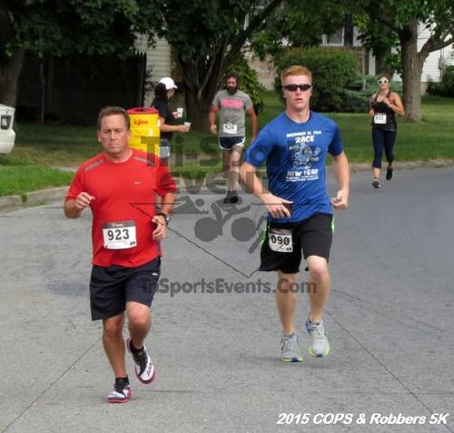 COPS & Robbers 5K Run/Walk<br><br><br><br><a href='http://www.trisportsevents.com/pics/15_COPS_&_Robbers_5K_062.JPG' download='15_COPS_&_Robbers_5K_062.JPG'>Click here to download.</a><Br><a href='http://www.facebook.com/sharer.php?u=http:%2F%2Fwww.trisportsevents.com%2Fpics%2F15_COPS_&_Robbers_5K_062.JPG&t=COPS & Robbers 5K Run/Walk' target='_blank'><img src='images/fb_share.png' width='100'></a>