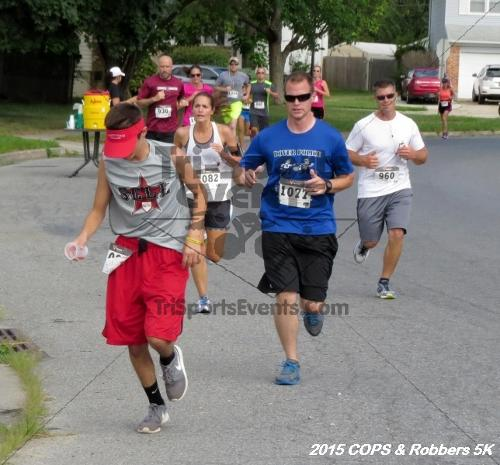 COPS & Robbers 5K Run/Walk<br><br><br><br><a href='https://www.trisportsevents.com/pics/15_COPS_&_Robbers_5K_067.JPG' download='15_COPS_&_Robbers_5K_067.JPG'>Click here to download.</a><Br><a href='http://www.facebook.com/sharer.php?u=http:%2F%2Fwww.trisportsevents.com%2Fpics%2F15_COPS_&_Robbers_5K_067.JPG&t=COPS & Robbers 5K Run/Walk' target='_blank'><img src='images/fb_share.png' width='100'></a>