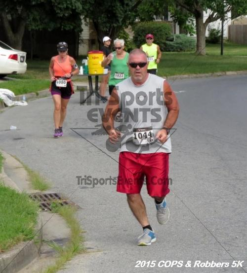COPS & Robbers 5K Run/Walk<br><br><br><br><a href='https://www.trisportsevents.com/pics/15_COPS_&_Robbers_5K_072.JPG' download='15_COPS_&_Robbers_5K_072.JPG'>Click here to download.</a><Br><a href='http://www.facebook.com/sharer.php?u=http:%2F%2Fwww.trisportsevents.com%2Fpics%2F15_COPS_&_Robbers_5K_072.JPG&t=COPS & Robbers 5K Run/Walk' target='_blank'><img src='images/fb_share.png' width='100'></a>