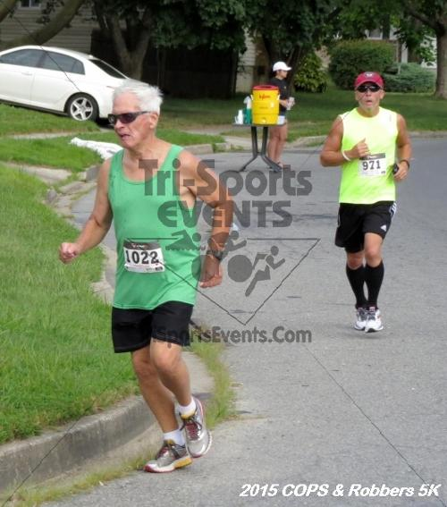 COPS & Robbers 5K Run/Walk<br><br><br><br><a href='https://www.trisportsevents.com/pics/15_COPS_&_Robbers_5K_074.JPG' download='15_COPS_&_Robbers_5K_074.JPG'>Click here to download.</a><Br><a href='http://www.facebook.com/sharer.php?u=http:%2F%2Fwww.trisportsevents.com%2Fpics%2F15_COPS_&_Robbers_5K_074.JPG&t=COPS & Robbers 5K Run/Walk' target='_blank'><img src='images/fb_share.png' width='100'></a>