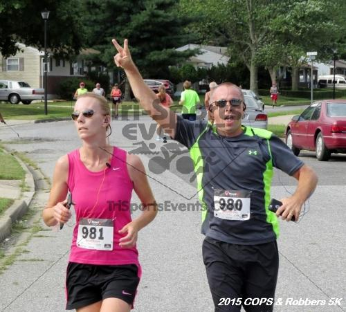 COPS & Robbers 5K Run/Walk<br><br><br><br><a href='https://www.trisportsevents.com/pics/15_COPS_&_Robbers_5K_126.JPG' download='15_COPS_&_Robbers_5K_126.JPG'>Click here to download.</a><Br><a href='http://www.facebook.com/sharer.php?u=http:%2F%2Fwww.trisportsevents.com%2Fpics%2F15_COPS_&_Robbers_5K_126.JPG&t=COPS & Robbers 5K Run/Walk' target='_blank'><img src='images/fb_share.png' width='100'></a>
