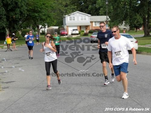 COPS & Robbers 5K Run/Walk<br><br><br><br><a href='https://www.trisportsevents.com/pics/15_COPS_&_Robbers_5K_127.JPG' download='15_COPS_&_Robbers_5K_127.JPG'>Click here to download.</a><Br><a href='http://www.facebook.com/sharer.php?u=http:%2F%2Fwww.trisportsevents.com%2Fpics%2F15_COPS_&_Robbers_5K_127.JPG&t=COPS & Robbers 5K Run/Walk' target='_blank'><img src='images/fb_share.png' width='100'></a>